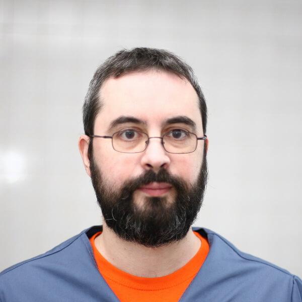 Dr. Andrius Surovas